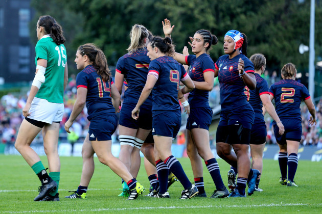 Romane Menager celebrates scoring a try with teammates
