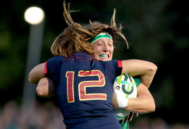 Lindsay Peat tackled by Elodie Poublan