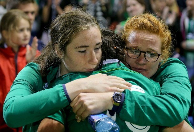 Hannah Tyrrell is comforted by friends after the game
