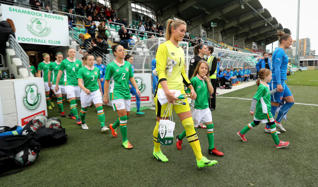 Emma Byrne leads out her team