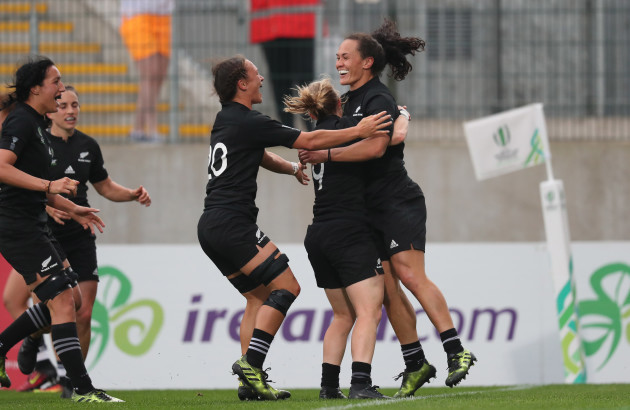 Portia Woodman celebrates scoring her fourth try with teammates