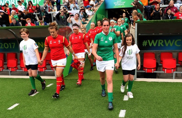 Nora Stapleton leads the Ireland team out on her 50th cap