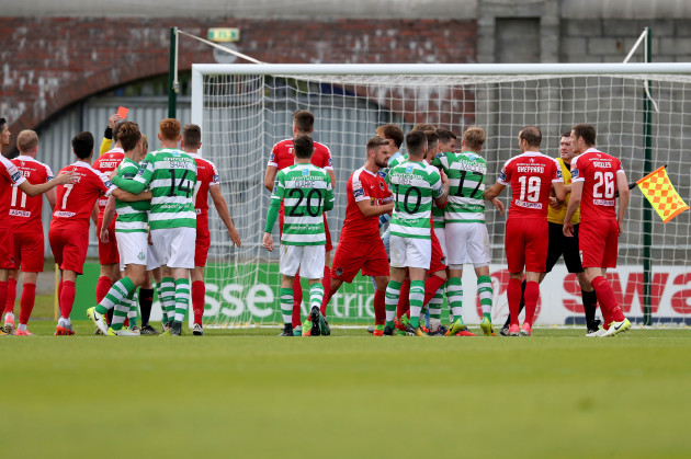 A scuffle breaks out between Shamrock Rovers players and Cork City players