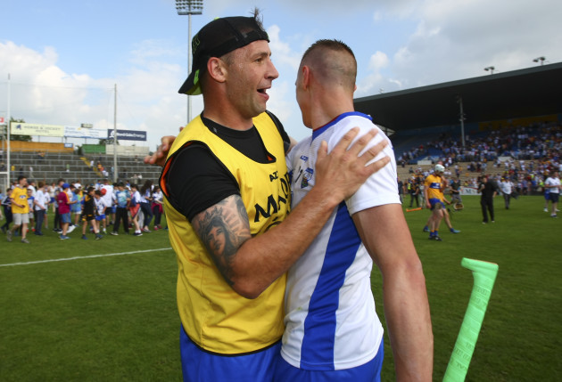 Dan Shanahan congratulates brother Maurice Shanahan at the end of the game