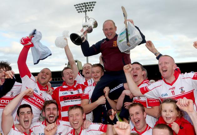 Derek McGrath celebrates with his team