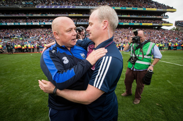 Derek McGrath and Michael Donoghue embrace after the game