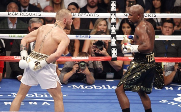 Conor McGregor in action against Floyd Mayweather Jr