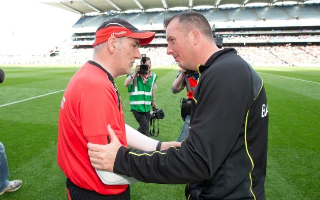 Mickey Harte shakes hands with Niall Carew after the game