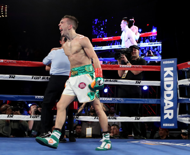 Michael Conlan celebrates his win by TKO