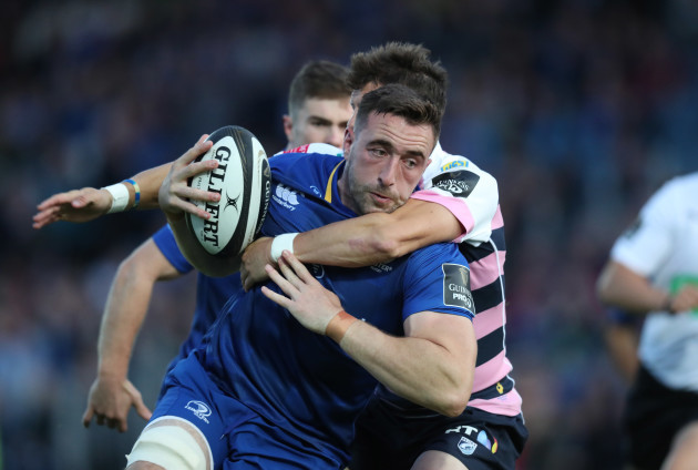 Jack Conan is tackled by Lloyd Williams