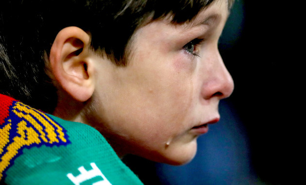 A tearful young Irish fan late in the game