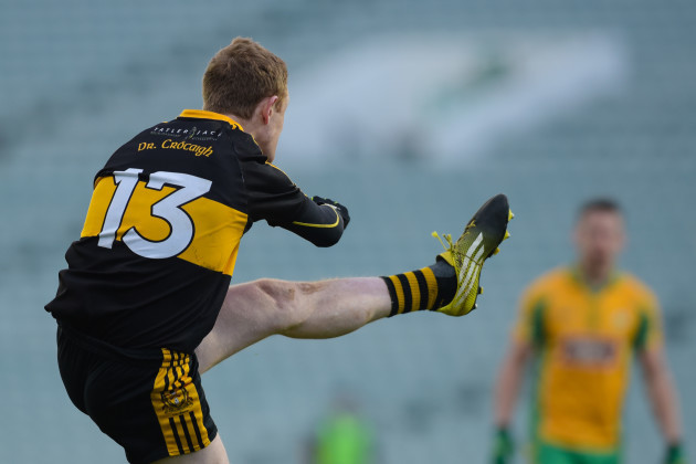Colm Cooper kicks a point from a free