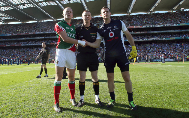 Andy Moran and Stephen Cluxton with referee Joe McQuillan