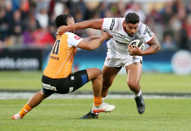 Charles Piutau is tackled by Clayton Blommetjies