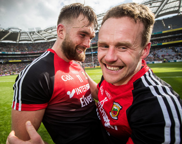 Aidan O'Shea and Andy Moran celebrate after the game