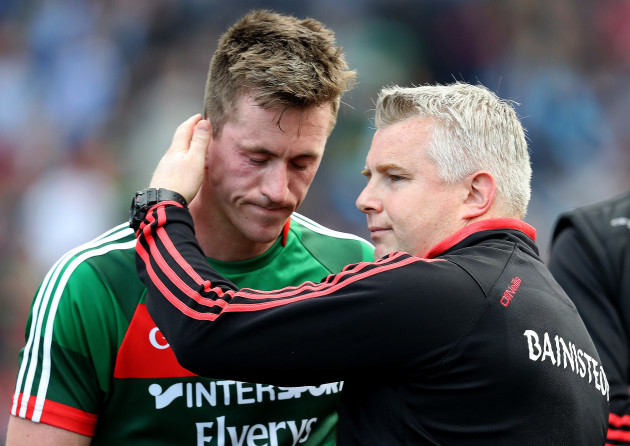 Stephen Rochford and Cillian O'Connor dejected after the game