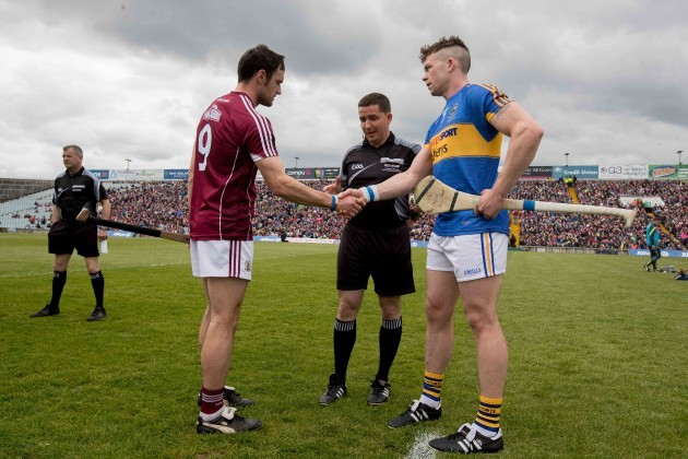 Galway captain David Burke with Tipperary captain Padraic Maher