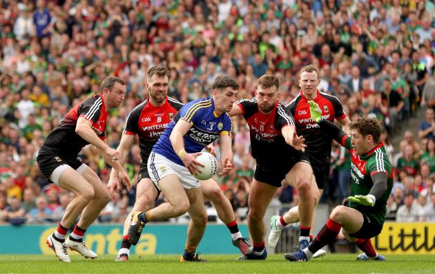 Keith Higgins, Seamus O'Shea, Aidan O'Shea, David Clarke and Colm Boyle tackle Paul Geaney