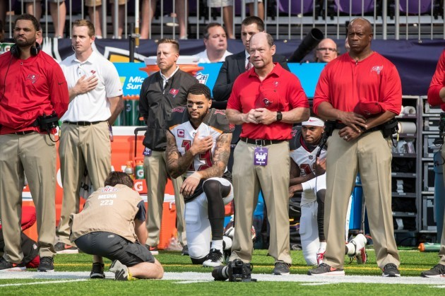 NFL PLayers and Owners Protest During Singing of National Anthem