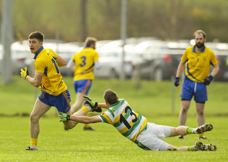 Conor Gleeson escapes the tackle of Chris OÕDonovan