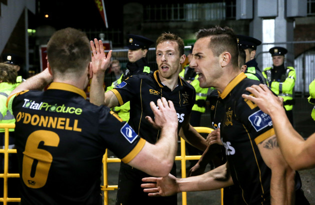David McMillan celebrates scoring a goal with Stephen O'Donnell and Dylan Connolly