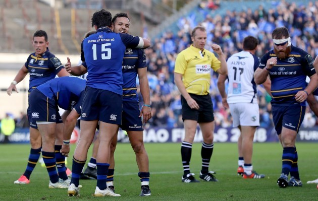 Jamison Gibson-Park and Joey Carbery celebrate at the full time whistle