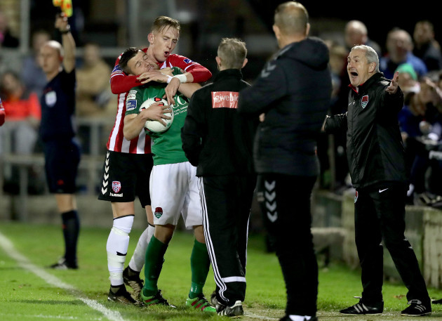 Steven Beattie with Ronan Curtis tussle on the sideline