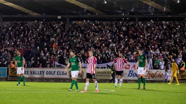 Cork City fans hold lights during the game