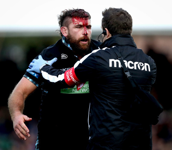 Callum Gibbins with a blood injury after a clash of heads
