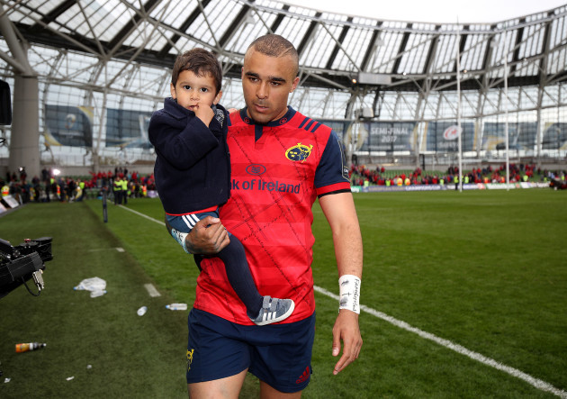 Simon Zebo leaves the field with his son Jacob