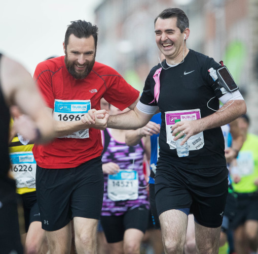 Runners share a joke during the Dublin Marathon