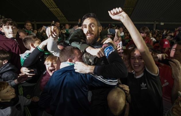 Mark McNulty jumps into the crowd at the shed end to celebrate