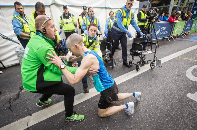 Jeremy Curran falls to the floor after completing The SSE Airtricity Dublin Marathon