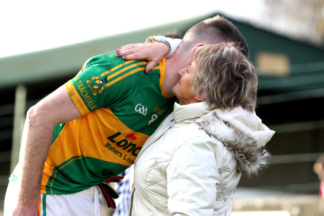 Seamus Kennedy is consoled by his grandmother Mary Wall after the game