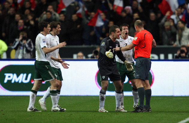 Shay Given and Sean St. Ledger appeal to referee Martin Hansson