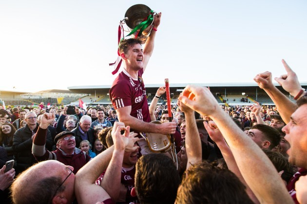 Ollie Walsh celebrates after the game with the trophy