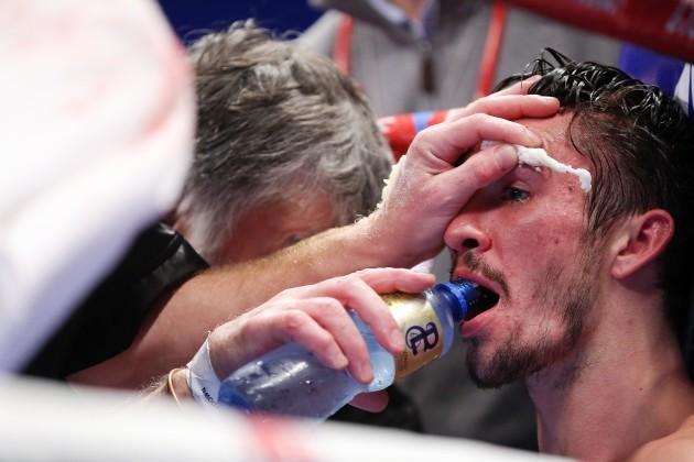 Jamie Conlan is treated between rounds