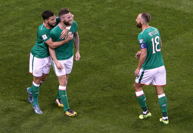 Daryl Murphy celebrates his first goal with Shane Long and David Meyler