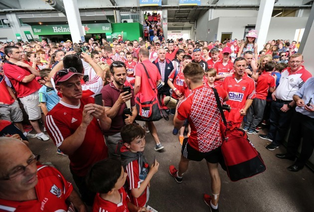 Cork team are greeted by supporters