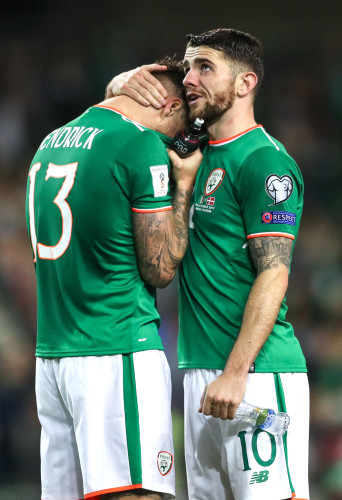 Jeff Hendrick and Robbie Brady dejected after the match