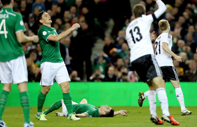 Keith Andrews and Seamus Coleman dejected