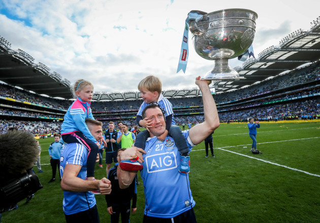 Denis Bastick celebrates with his son Aidan and The Sam Maguire