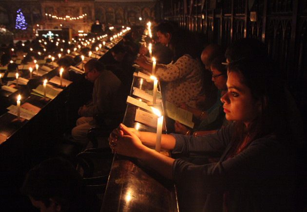 India: Midnight Mass Candle Light in Kolkata