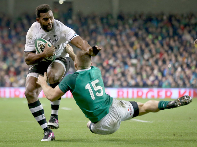 Timoci Nagusa is tackled by  Andrew Conway