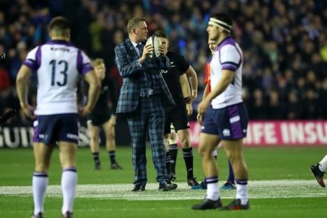 Doddie Weir delivers the match ball