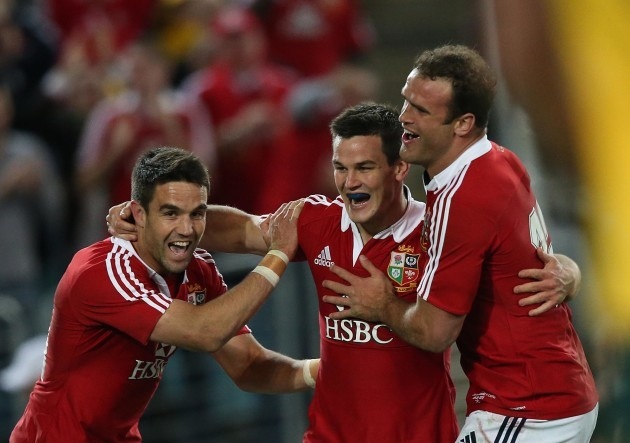 British and Irish Lions's  Conor Murray Jonathan Sexton and Jamie Roberts celebrate after Jonathan Sexton scores