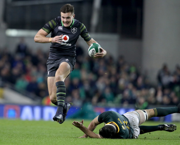 Jacob Stockdale makes a break past Francois Louw