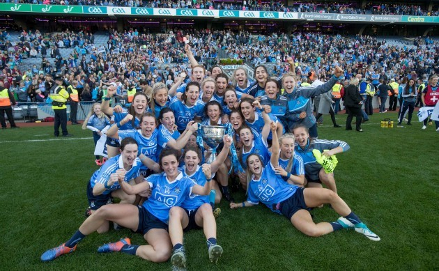Dublin players celebrates with the Brendan Martin Cup
