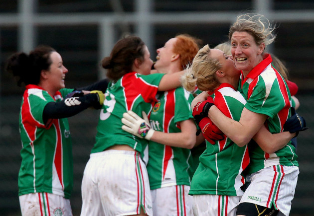 Aoife Loftus and Cora Staunton celebrate at the final whistle