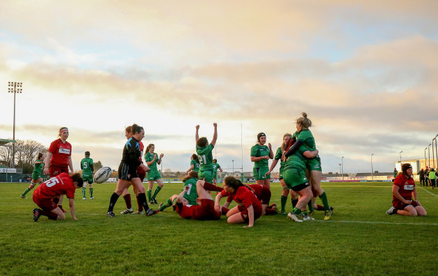 Connacht celebrate crossing for a try.